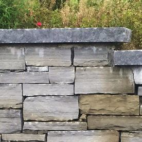 Dressed rock face complimenting a dry grey sandstone wall