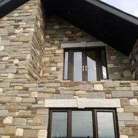 Mixed sandstone complimented with granite heads