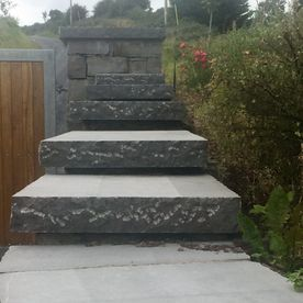 Stepped pitched rock face capping