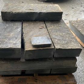 Rustic grey/brown sandstone steps ready for dispatch