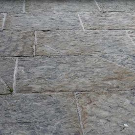 Cut regular grey brown paving