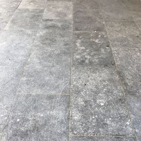 Kilkenny flamed paving featuring some natural fossil