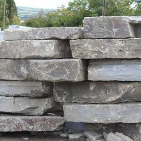 Large flat grey sandstone rock armour