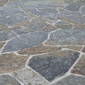 Random grey & brown sandstone paving
