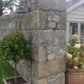 Grey & brown granite mix with large hand dressed corner stones