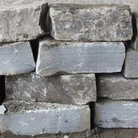 Oversized split grey sandstone rock armour
