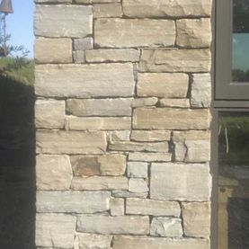 Dressed grey sandstone with various tones of green & Grey tints